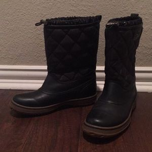 Coach water resistant boots  with Rubber Soles.